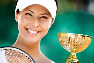 Tennis player won the cup at the sport match. Prize