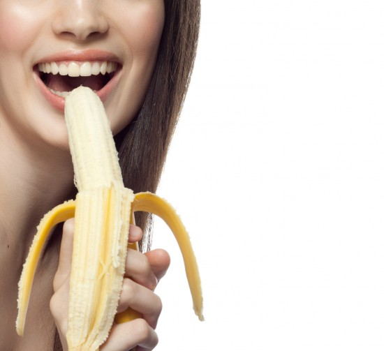 closeup portrait of attractive caucasian smiling woman brunette isolated on white studio shot lips toothy smile face hair head and shoulders bananas